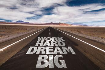 Work Hard Dream Big written on desert road-1