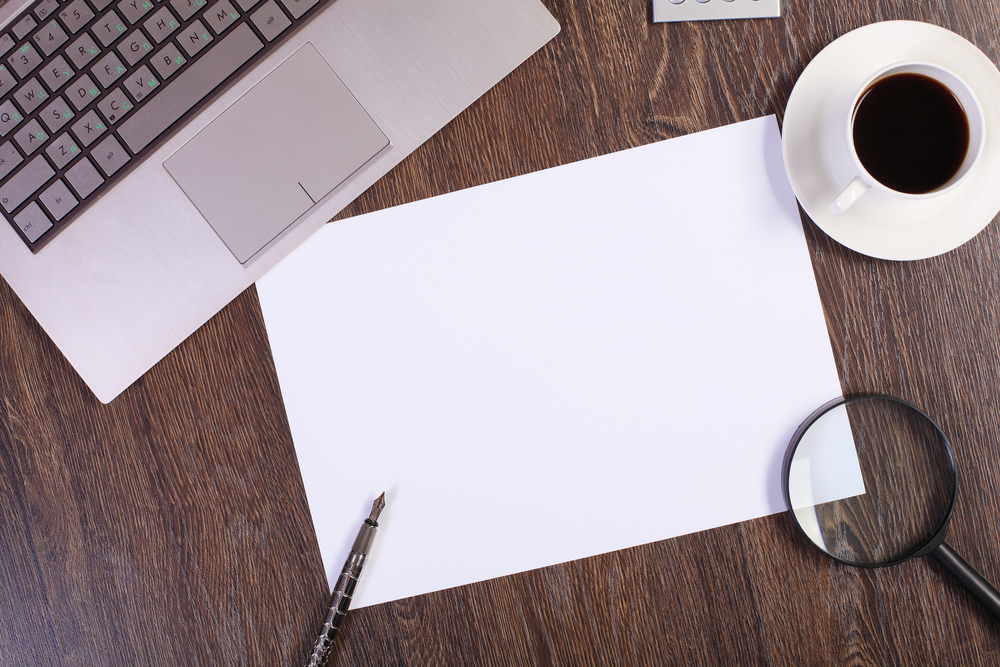 Business papers and a cup of coffee on the table-1